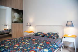 A bed or beds in a room at Downtown pedestrian zone apartment