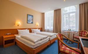 Ein Bett oder Betten in einem Zimmer der Unterkunft City Hotel Valois