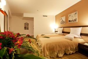 A bed or beds in a room at Earth & People Hotel & SPA
