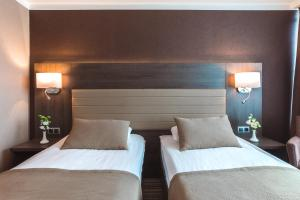 A bed or beds in a room at Premier Hotel Rus