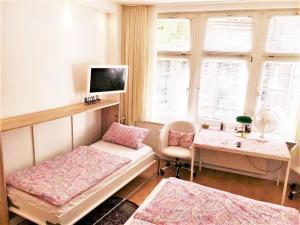 Ein Bett oder Betten in einem Zimmer der Unterkunft CGN Apartments - Altstadt