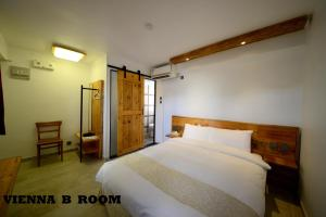 A bed or beds in a room at B & B Cheung Chau