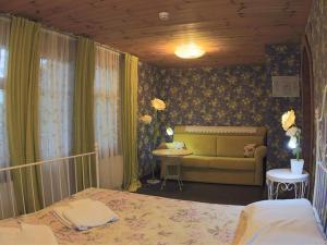 Кровать или кровати в номере Волга-Волга