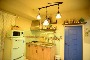 A kitchen or kitchenette at Residence Unicorn