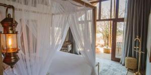 Un ou plusieurs lits dans un hébergement de l'établissement Nkala Safari Lodge