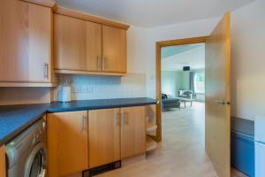 A kitchen or kitchenette at 4 Kinnessburn Cottages