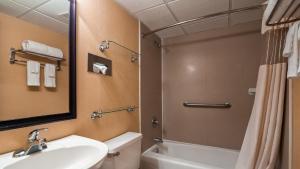A bathroom at Best Western Galaxy Inn