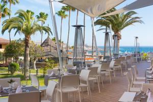 Een restaurant of ander eetgelegenheid bij Iberostar Bouganville Playa