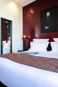 Un ou plusieurs lits dans un hébergement de l'établissement Hotel Arok