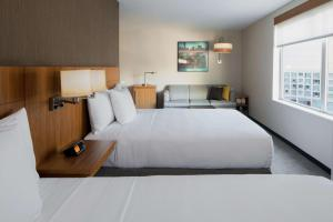 A bed or beds in a room at Hyatt Place Long Island City