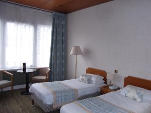 A bed or beds in a room at Arrochar Hotel 'A Bespoke Hotel'