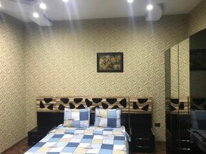 Cama ou camas em um quarto em Apartament on Samed Vurgun avenue