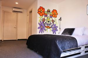 A bed or beds in a room at Nomads Hotel
