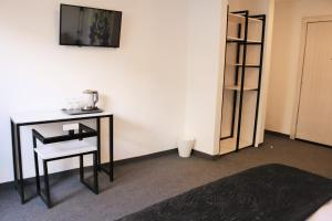 A television and/or entertainment center at Nomads Hotel