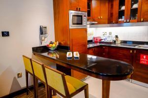 مطبخ أو مطبخ صغير في Grand Mercure Abu Dhabi