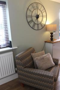 A seating area at Wisteria way cottage