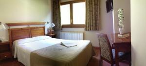 Кровать или кровати в номере Hotel Xalet Verdú