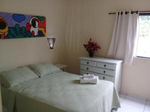 A bed or beds in a room at Pousada Vaca Brava