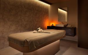 A bed or beds in a room at The View Lugano