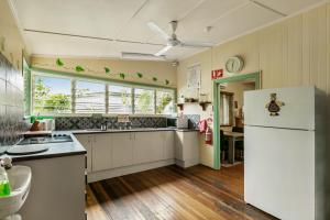 A kitchen or kitchenette at Tropic Days Boutique Hostel