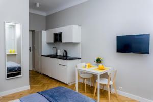 Telewizja i/lub zestaw kina domowego w obiekcie 3V Apartments