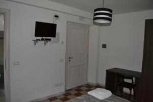 A television and/or entertainment center at Magia del Turano