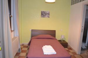 A bed or beds in a room at Magia del Turano