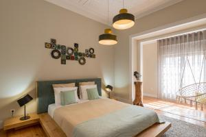 A bed or beds in a room at 19 Tile Ceramic Boutique House