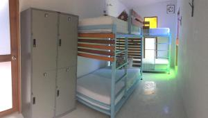 A bunk bed or bunk beds in a room at Hey beach hostel