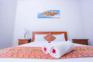 A bed or beds in a room at D'padang