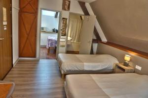 A bed or beds in a room at Residence Le Bellevue