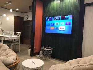 A television and/or entertainment centre at Family house (private house)