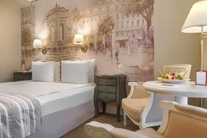 Кровать или кровати в номере Отель Реноме сети Оригинальные Отели
