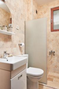 A bathroom at Apartments Residence Portofino