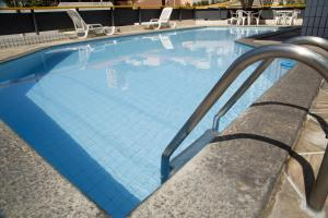 The swimming pool at or near Monza Palace Hotel