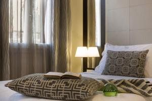 Ein Bett oder Betten in einem Zimmer der Unterkunft Palazzo Bezzi Hotel