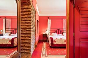 Litera o literas de una habitación en Abba Palacio de Soñanes Hotel