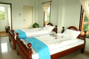 A bed or beds in a room at Thai Guesthouse