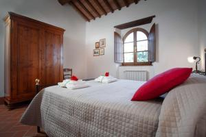 A bed or beds in a room at Agriturismo Le Celle