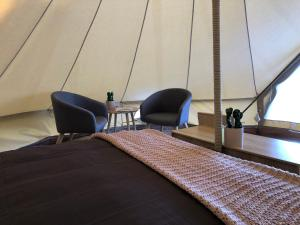 A bed or beds in a room at Mornington Peninsula Glamping