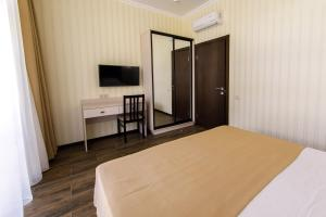 A bed or beds in a room at Hotel Coral