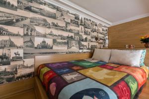 Кровать или кровати в номере Ваш дом у Исаакиевского собора