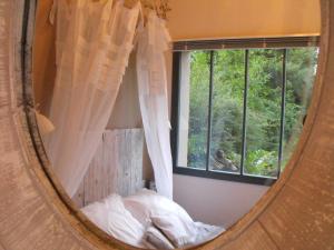 Un ou plusieurs lits dans un hébergement de l'établissement Chambres d'Hôtes la Maison de Juliette