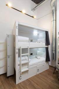 A bunk bed or bunk beds in a room at Airhostel Barcelona Airport 24h