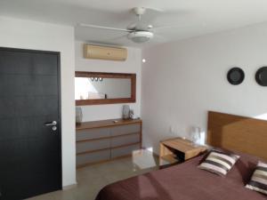 Cama o camas de una habitación en One bedroom condo on the beach at Amara Cancun