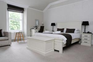A bed or beds in a room at Court Colman Manor