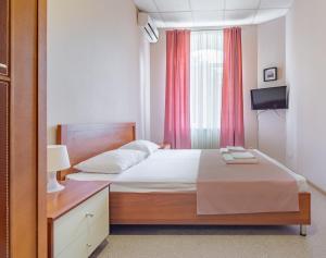 Lova arba lovos apgyvendinimo įstaigoje Hotel Gostinyj Dom