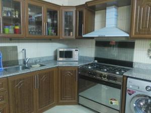 A kitchen or kitchenette at Abo-khaled Amman Street