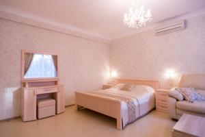 Кровать или кровати в номере Апарт-Отель Артепартс
