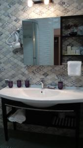 Ванная комната в Hotel Zolotoy Drakon